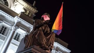 , Poland LGBT protests: Three charged with hanging rainbow flags off statues